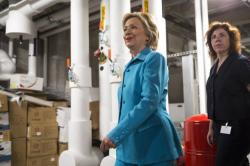 Clinton a day after releasing her energy and climate plan at LEED-certified, energy-efficient bus station in Des Moines, Iowa.