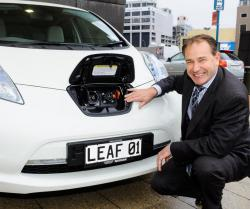 Phil Heatley checks out the Leaf's recharging unit.
